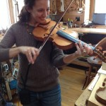 Trip Organizer Robin performs on one of Tom's violins.